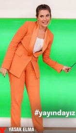 Eda Ece turuncu takım elbise